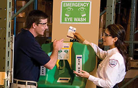 Cintas representative explaining eyewash station service
