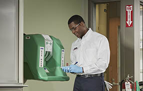 Cintas representative updating the service record of a Safety Director eyewash station