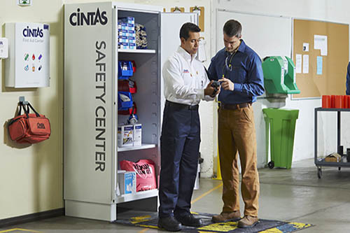 Cintas representative explaining safety cabinet items