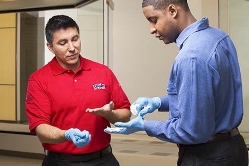 Cintas representative explains how to remove gloves after taking care of an emergency.