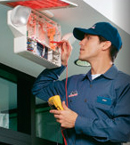 Cintas technician inspecting emergency lighting