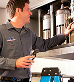 Cintas technician repairing fire suppression system