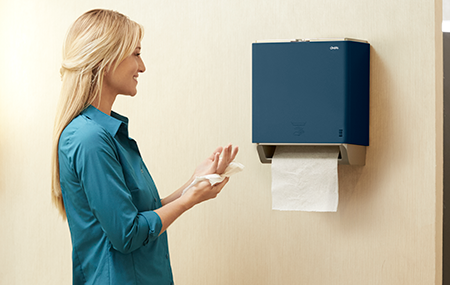 Person using a Cintas Indigo Signature Series Automatic Paper Towel Dispenser