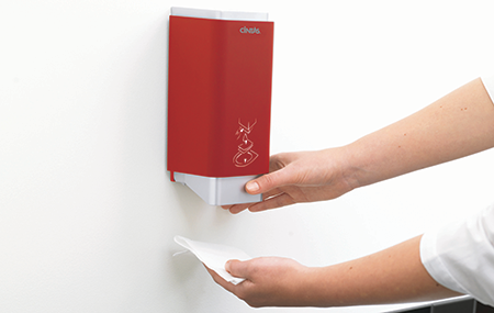 Person using a Cintas Red Signature Series Toilet Seat Cleaner Dispenser