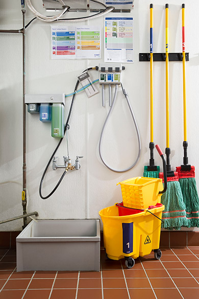 Organized and clean slop sinks, mops, bucket, and filled chemicals after Cintas services
