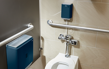 Cintas Indigo Urinal & Toilet Sanitizer installed above a toilet