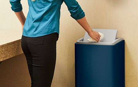Person using a Cintas Indigo Signature Series Trash Can