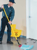 Custodian cleaning with mop