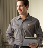 Man wearing gray work shirt
