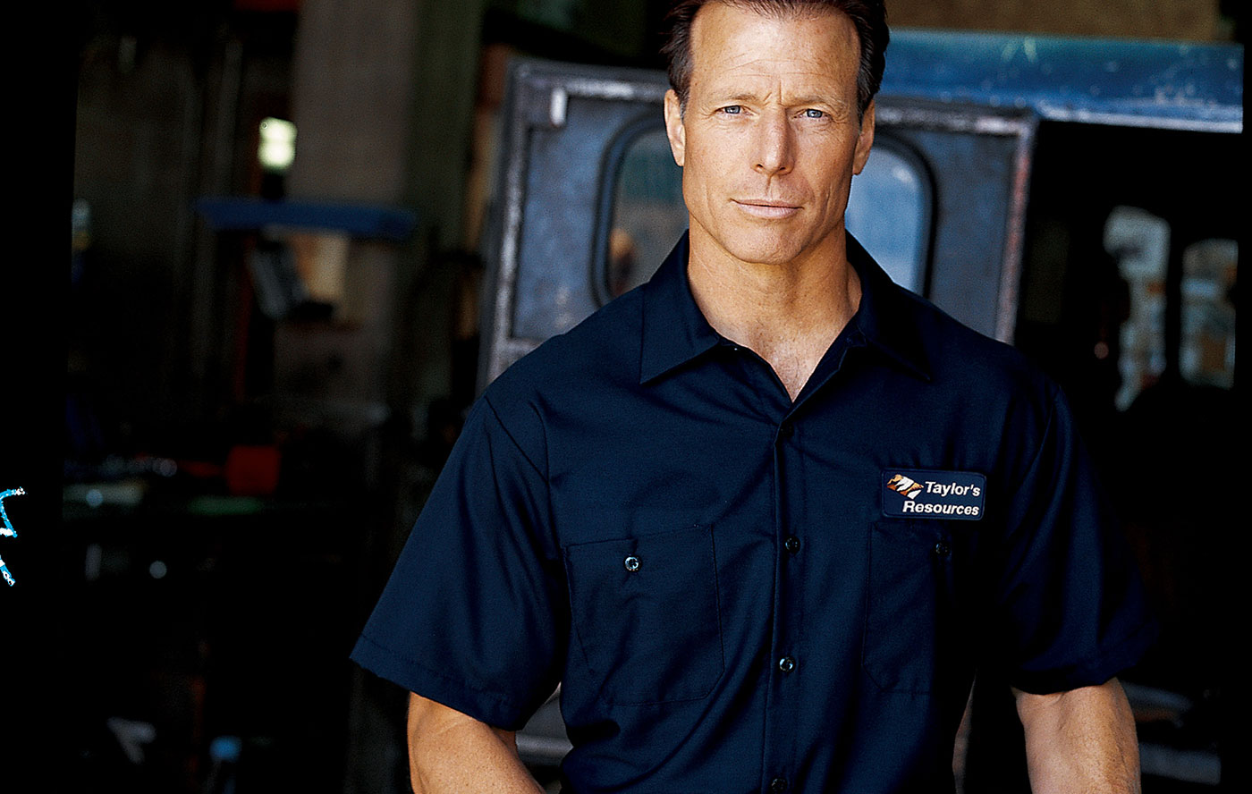 Mechanic in automotive coveralls