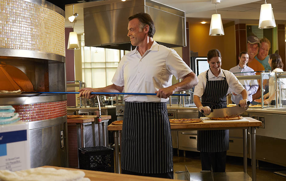 Pizza Chef wearing a ChefWorks® Chalk Stripe Apron
