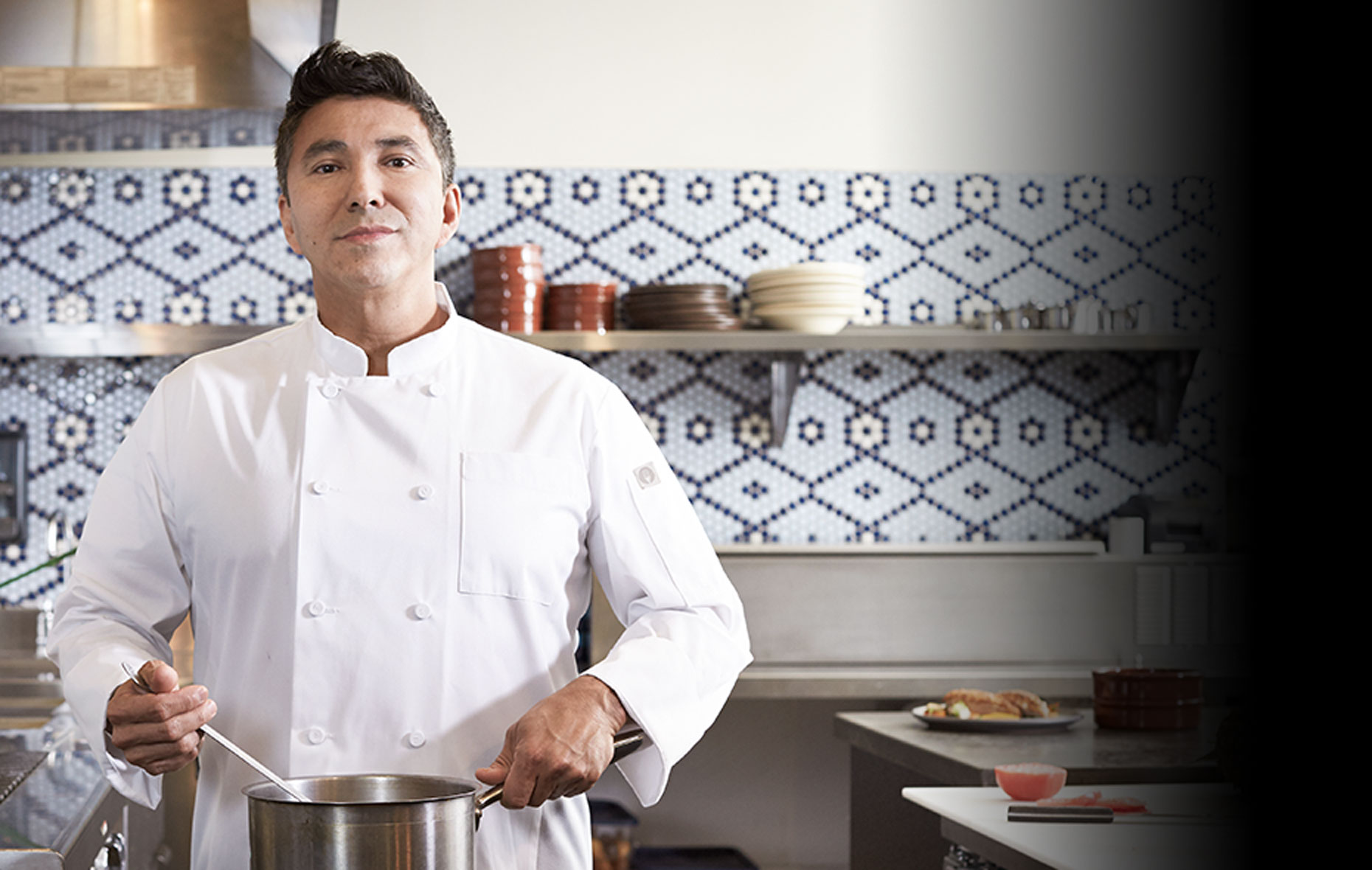 Chef in ChefWorks™ white Signature Chef coat in a kitchen
