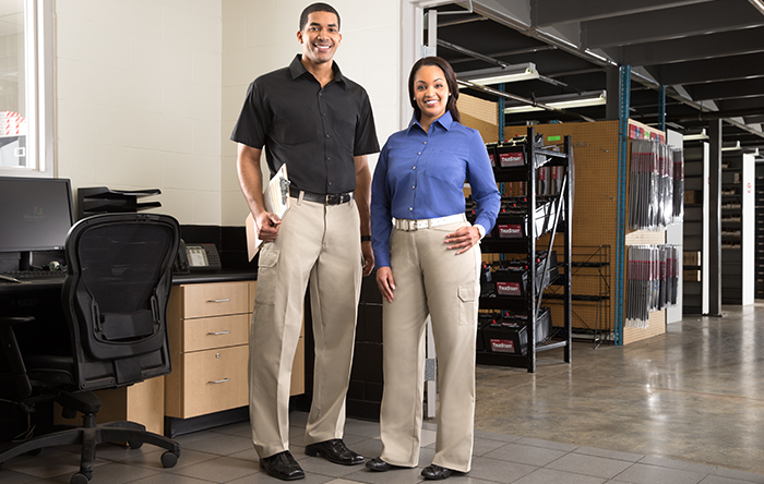Male and female employees in custom button down shirts