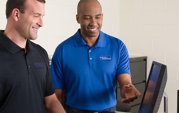 Tech employees in custom embroidered polos