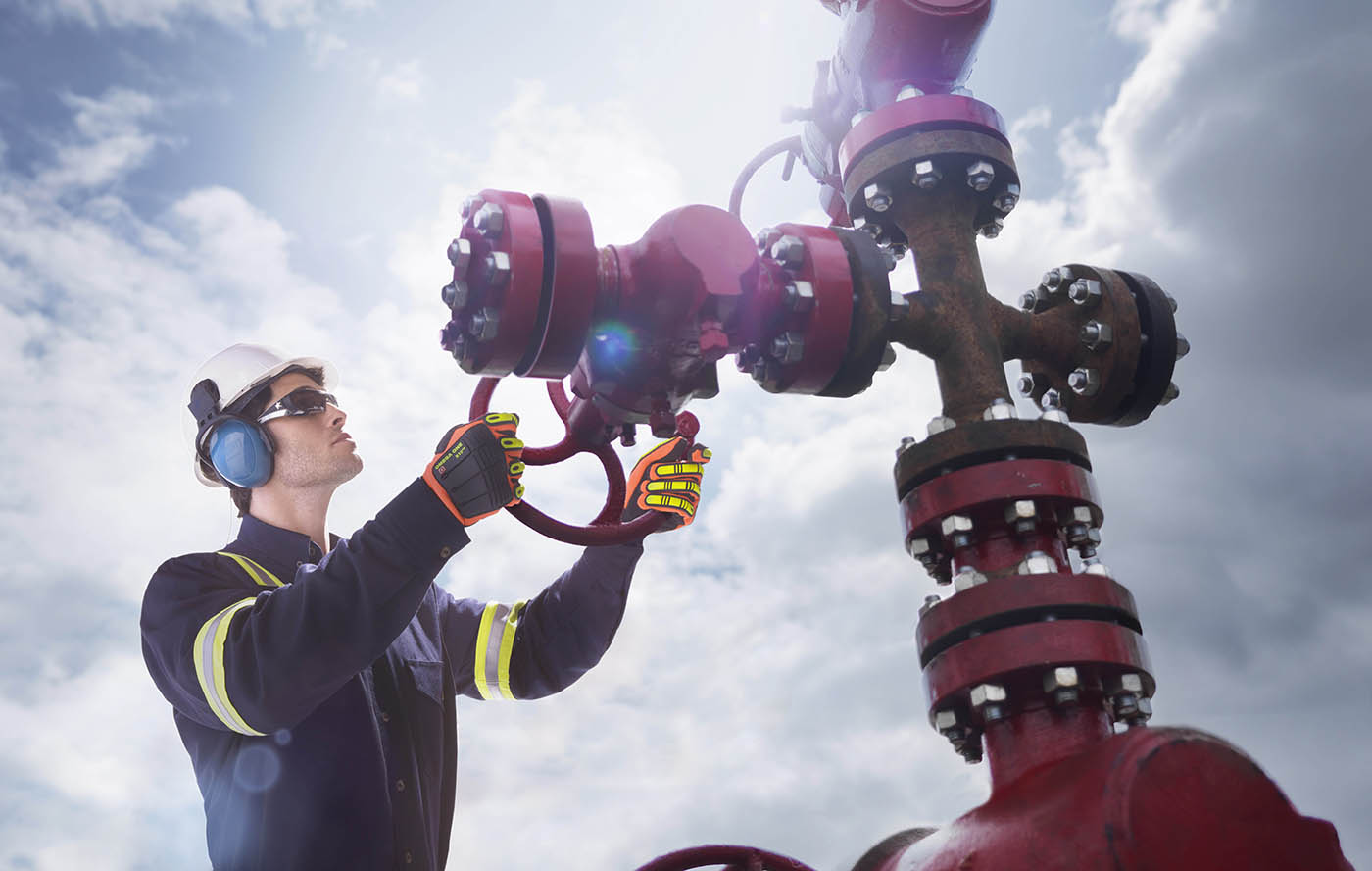Oil/Gas worker in high visibility flame resistant coveralls