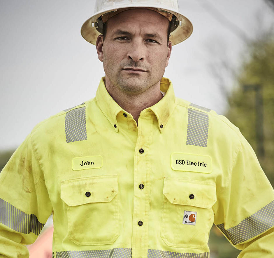 Utility worker in high visibility, flame resistant clothing