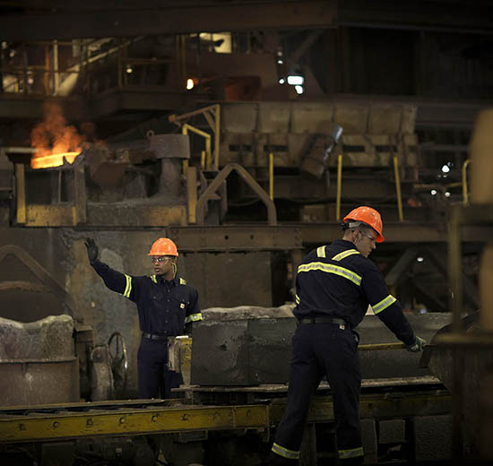 Steel workers in Molten Metal Splash Resistant Clothing