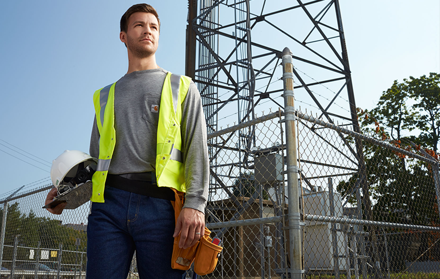 Utility employee in Carhartt long-sleeve tshirt, and high visibility vest