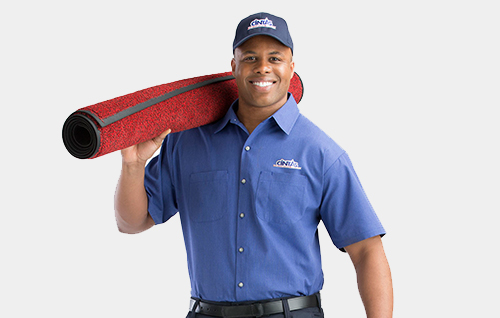 Cintas representative with rolled up mat