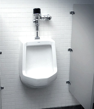 Clean urinal after Cintas restroom cleaning services